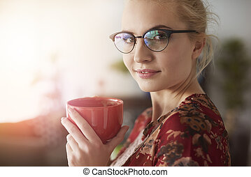 Close up of businesswoman with coffee