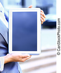 Close-up of businesswoman working with touchpad outdoor