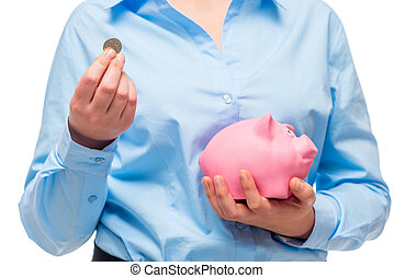 Close-up of businesswoman's hands with a pink piggy bank