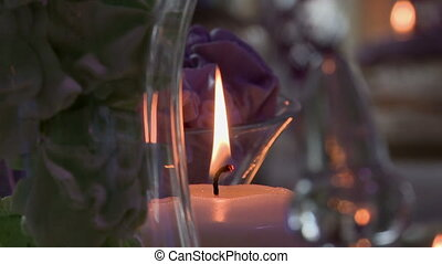 Close-up of candle flame on glass backdrop