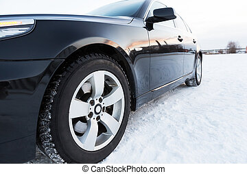 Close up of car tires on the winter road