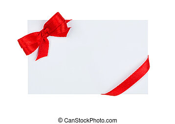 Close up of card with red ribbon bow on white background