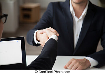 CEO shaking hand of male job applicant