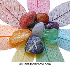 Close up of Chakra Crystals on colored skeleton leaves