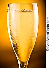 champagne flute on golden background