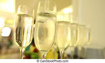 Close up of champagne glasses with celebration new year on the background.