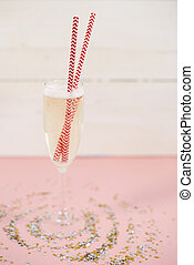 Close up of champagne with drinking straw