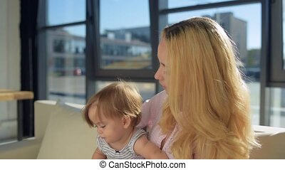 Close up of cheerful family sitting near the window
