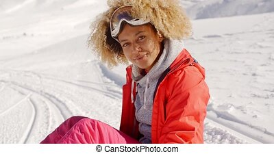Close up of cheerful woman on snowy hill