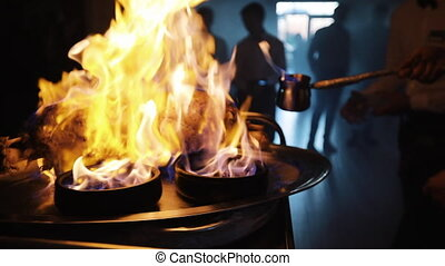 Close-up of chef cooking a main banquet dish. Present main...