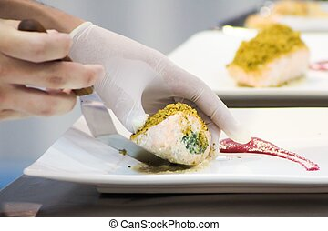Close up of chef decorating salmon steak on the plate