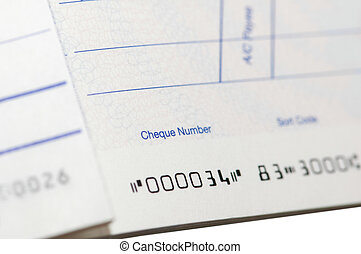 Close up of cheque book - shallow depth of field