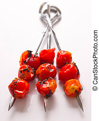 close up of cherry tomato skewers