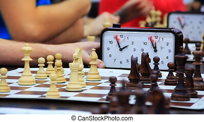 Close-up of chess game tournament with clock. Time lapse
