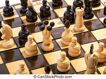 Close up of chess pieces on a board during a game