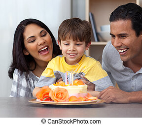 Close-up of child celebrating his birthday with his parents