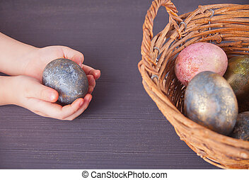 Close up of child holding colorful Easter eggs
