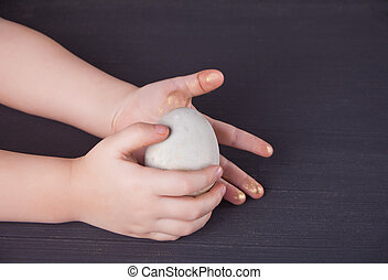 Close up of child holding Easter eggs