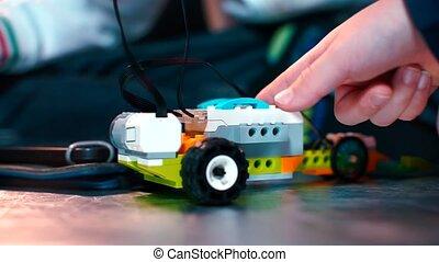 Close-up of childrehands assembling a constructor.