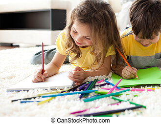 Close-up of children drawing lying on the floor