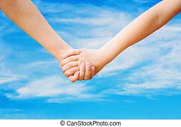 Close up of children holding his hand in summer park outdoor, ag