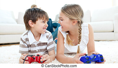Close-up of children playing video games