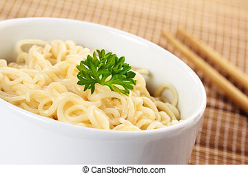 close up of chinese noodles garnished with parsley