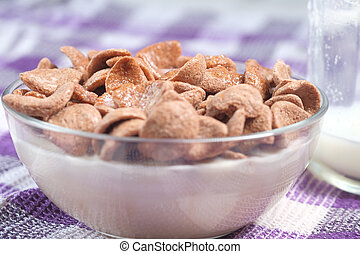 close up of chocolate flakes and milk on table