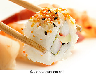 california roll - close up of chopsticks with california...