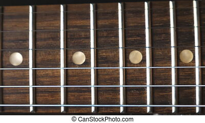 Close up of chords being strummed and vibrating during...