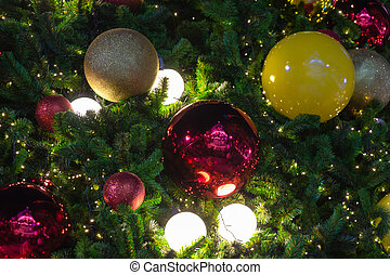 close up of christmas balls on christmas pine tree