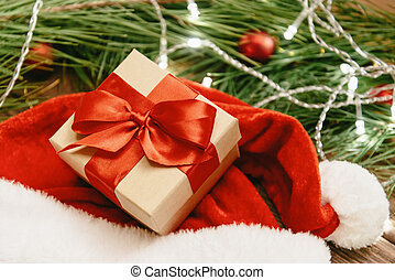 Close-up of Christmas gift box with red ribbon.