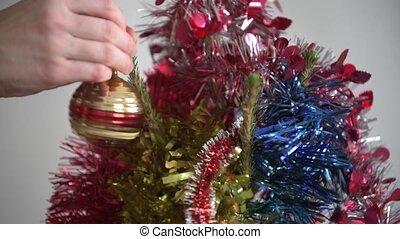 Close up of Christmas tree decorating