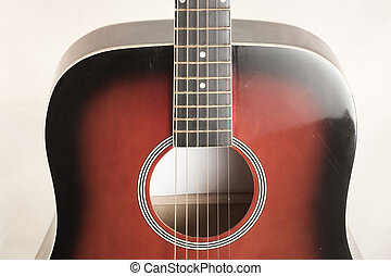 Close up of classic acoustic guitar. White background