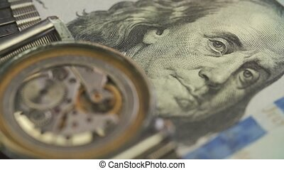 Close up of clockwork drive in a classy watch on the dollar...