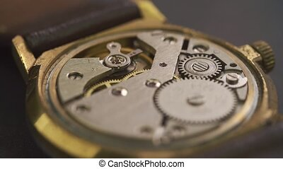 Close up of clockwork drive in a classy watch