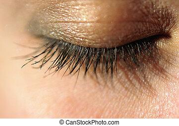 Close-up of closed eye with long eyelashes macro