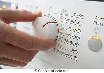 Close up of clothes washer dial