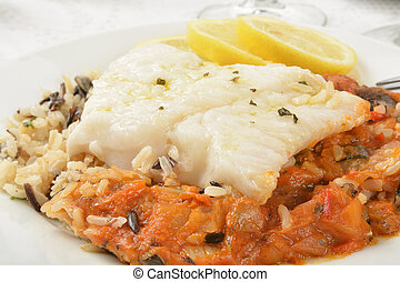Cod Provencal - Close up of Cod Provencal on wild rice with ...