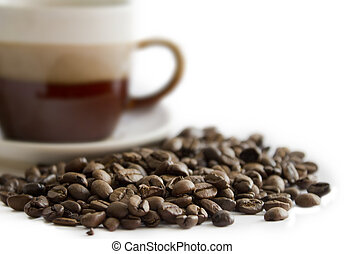 Close-up of coffee bean in front of a cup(2).jpg
