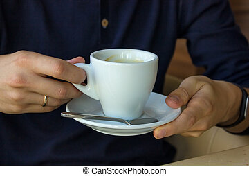 coffee cup in man's hands