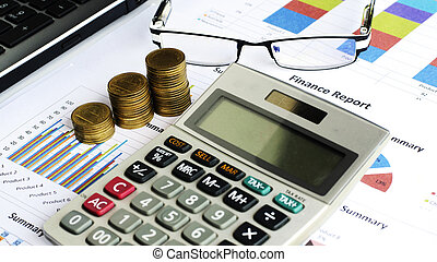 Close up of Coins stack and calculator and labtop with eyeglasses on financial chart backgrounds