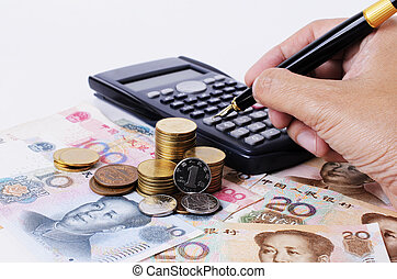 Close up of coins stack and calculator with fountain pen