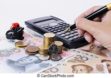 Close up of coins stack and pressing calculator with fountain pen