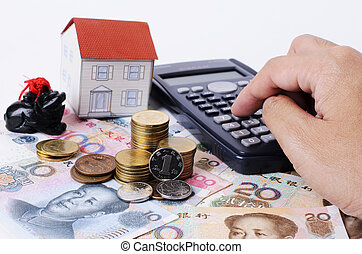 Close up of coins stack with pressing calculator for mortgage loans concept