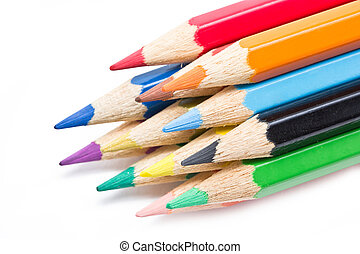 Close up of color pencils isolated on white background.
