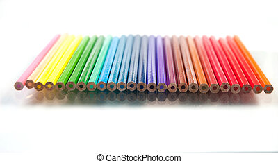 close up of color pencils on white
