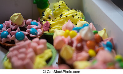 Close up of colorful and decorated cup cakes