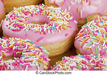 Close up of colorful and delicious donuts