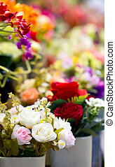 Close up of colorful artificial flowers.